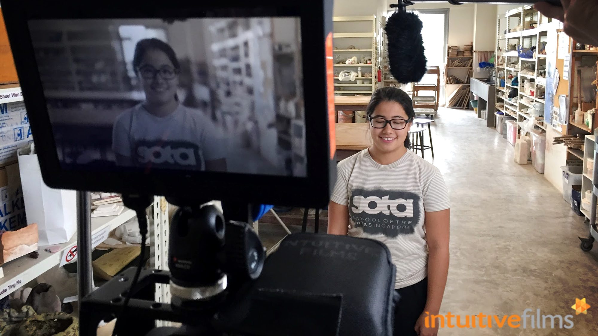 Lights, Camera... Action! Over at one of SOTA's ceramics studio, with one of the students roped in for the video production.